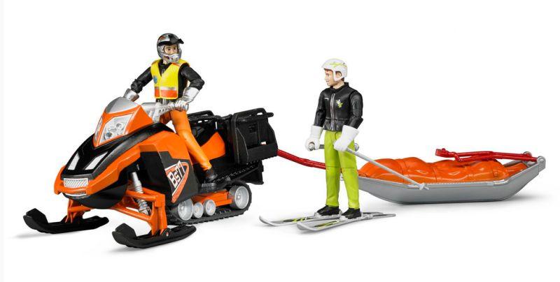 Bruder 63100 Sněžný skútr se záchranářskými sáněmi a figurka jezdce na lyžích